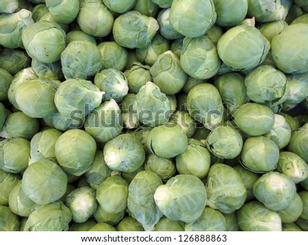 Pile of Brussel Sprouts on display at farmers market.