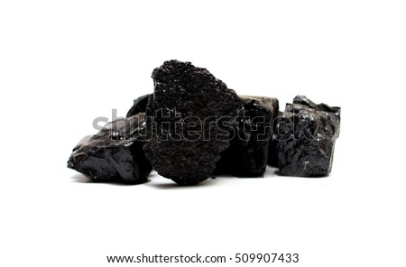 Pile of coal isolated on white background.
