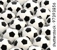 Pile of football black and white balls as a sport soccer background - stock photo