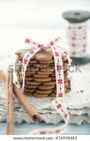 Pile of gingerbread cookies tied with a Christmas ribbon