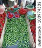 Pile of green chilli pepper on display for sale in the Pudu wet market in Kuala Lumpur, Malaysia. - stock photo