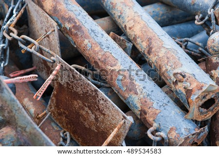 Pile of grunge and rusty metal tubes, plates and chains. Can be used as a background or texture.