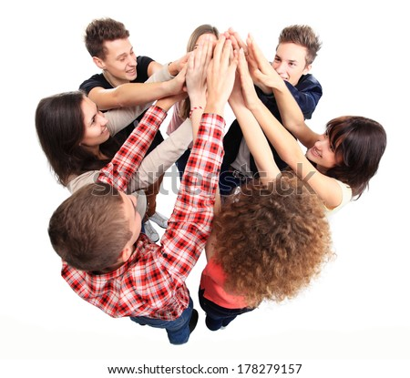 Pile of hands - Successful business team celebrating their success with a high five