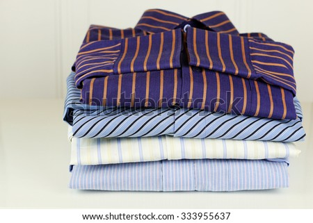 pile of ironing shirts and hand