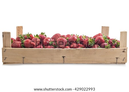 Pile of juicy ripe organic strawberries in a wooden box, crate, on a white background