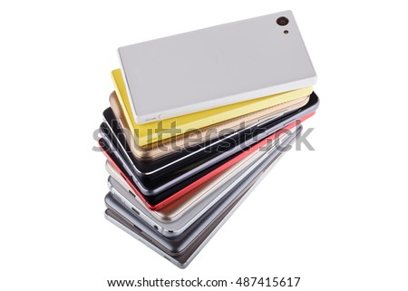 Pile of mobile phone. Heap of the different smart phones isolated on white background.