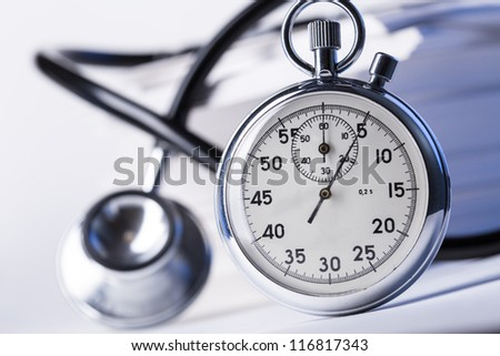 Pile of paper cards, stethoscope and stopwatch