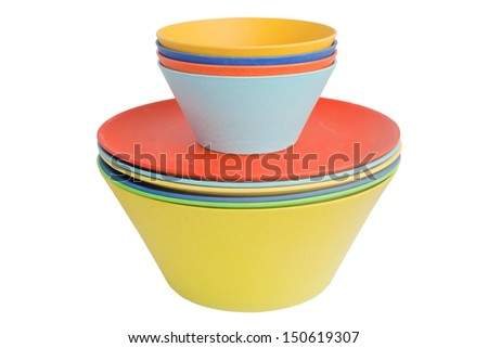 Pile of rainbow-colored bowls of various sizes isolated on white