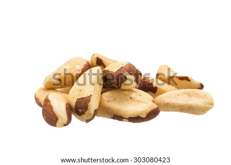 Pile of raw brazil nuts isolated on a white background