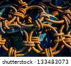 Pile of rusted chains at a boatyard. - stock photo