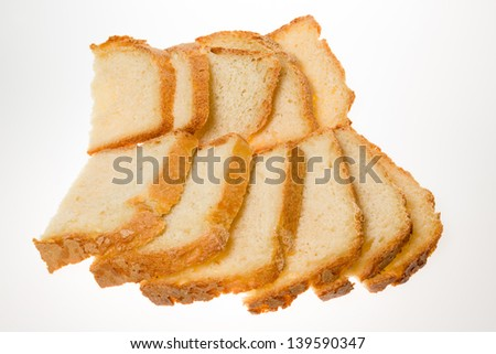 Pile of sliced bread on white background