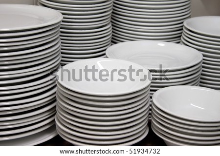 Piles of clean empty dishes