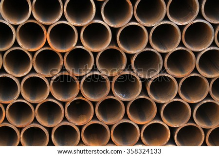 Piles of steel pipe, closeup of photo