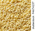 Pilled millet seeds as texture. - stock photo