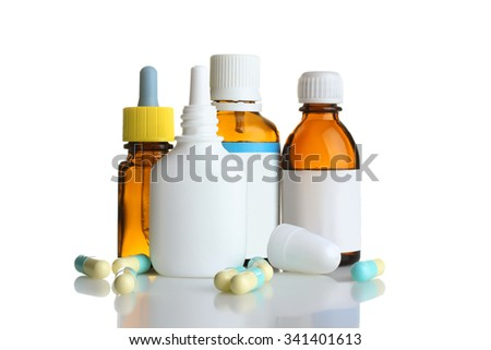 pills and bottle with the cure for the common cold isolated on white background