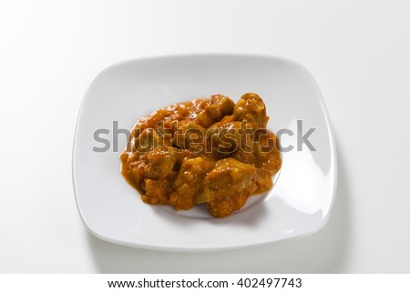 Pineapple pork casserole on a white plate