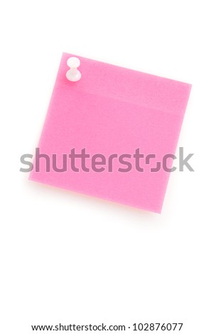 Pink adhesive note hanging with a pushpin against a white background