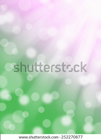 pink and green spring abstract bokeh background with light rays and sun spots
