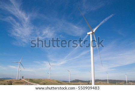 pink and red flowers garden background wind turbines