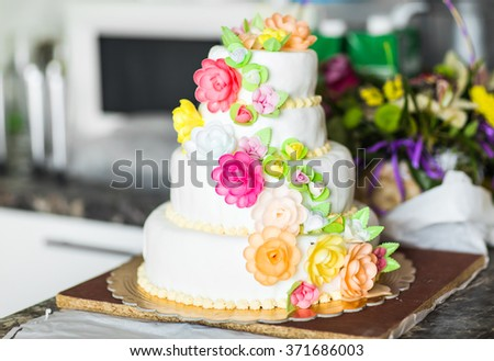 Pink and White Wedding Cake with Roses
