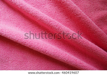 Pink background, soft microfiber fabric folds