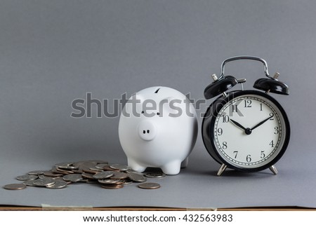 pink ceramic piggy bank over a grey background