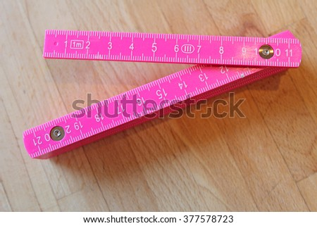 pink foldable ruler
