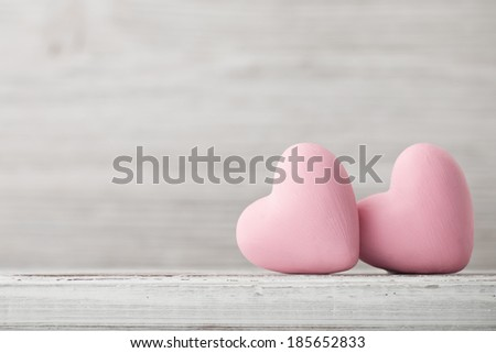 Pink heart on the wooden background. Provencal style.