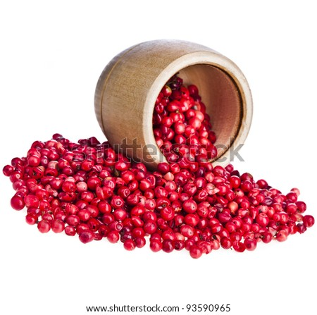 pink peppercorn in a wooden bowl , on white background.