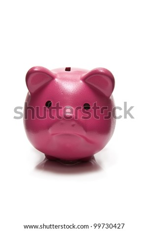 Pink piggy bank or money box isolated on a white studio background.