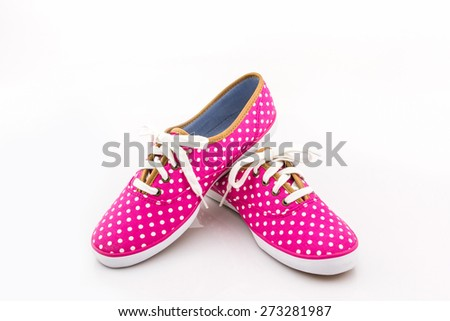 Pink polka dot sneakers on a white background. Canvas Shoe.