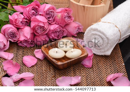 pink rose ,petals with candle in water ,towel and mat