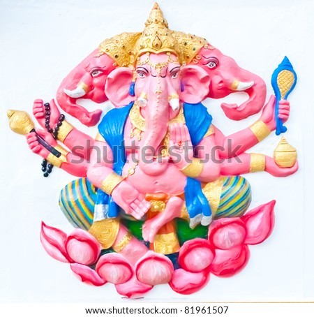 Pink six hands and three heads ganesha sitting on lotus on white wall