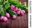 Pink tulips on a wooden background - stock photo