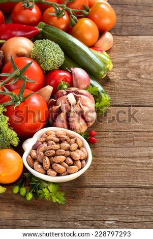 Pinto beans in a bowl and vegetables