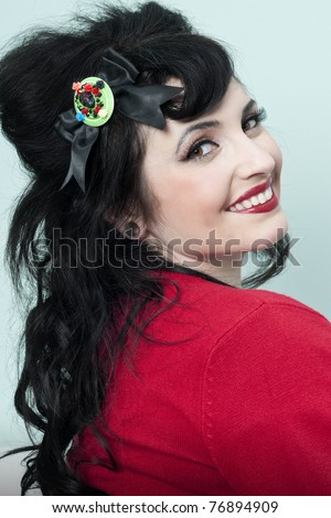 Pinup model smiling and wearing red sweater