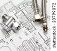 Pipes over house plan blueprints - stock photo