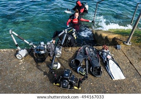 Piran, Slovenia - September 24, 2016: DRM Open - underwater photography splash-in competition in Slovenia. Underwater photographers are setting up photographic and diving equipement for scuba diving.