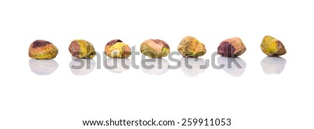 Pistachio nuts over white background