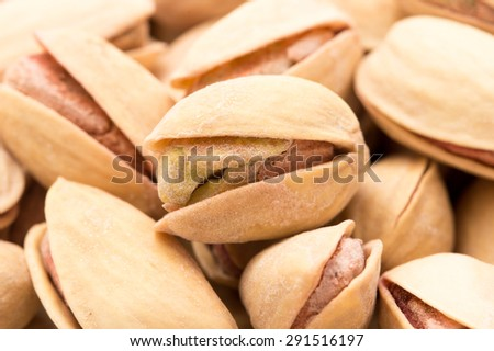 pistachios as a background. close