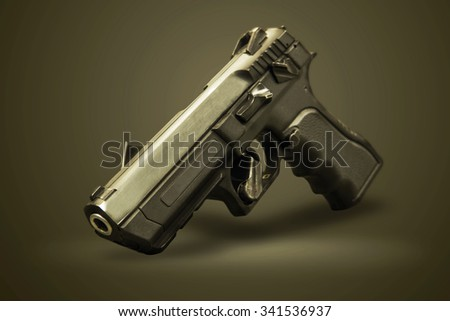 pistol gun on the green background