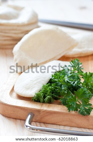 Pita bread over the cutting board