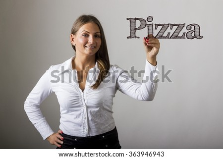 Pizza - Beautiful girl writing on transparent surface - horizontal image