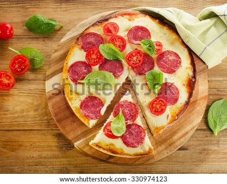 Pizza served on a wooden background. Top view