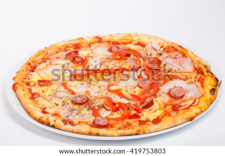 pizza with sausage and tomatoes