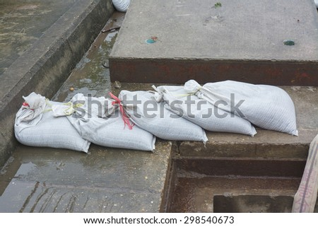 Place sandbags for flood protection