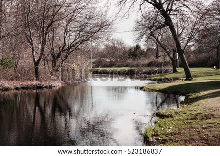 Placid stream in early spring along Mill Road in Fairhaven, Massachusetts