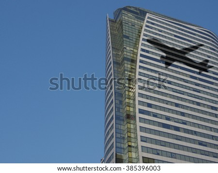Plane shadow on building background