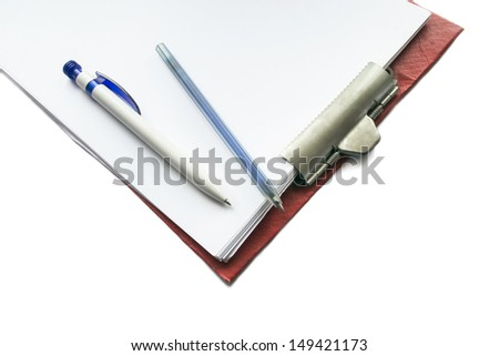 Plane tablet with metal clip with blank sheets of paper and two ink pens isolated over white