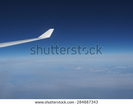 Plane wing with blue sky